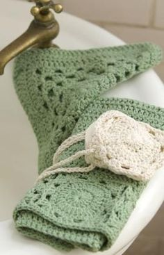 Finally, a washcloth that is simple and pretty. Bonus soap holder, scrubbie and more..