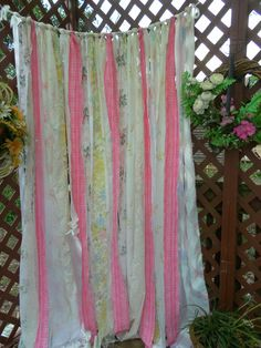 These ribbon backdrop/curtains will be easy peasy just buy a bunch of salvo good will sheets cut strips and tie to twine it's going to be a crafty winter this year!
