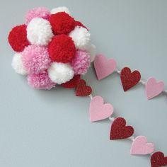 pompom and heart garland. you could do this with all different colors if you wanted to.