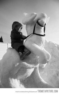 Epic tauntaun snow sculpture.That kid is so cute.