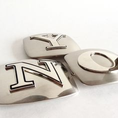 A personal favorite from my Etsy shop https://www.etsy.com/listing/269536532/initial-silver-tone-belt-buckle