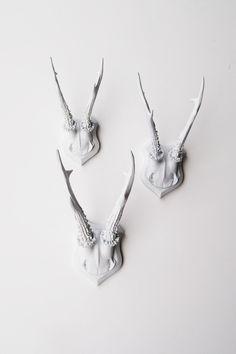 Faux Deer Antler Skull Caps - Faux Taxidermy - Set of 3 White Resin Deer Caps - Mounted Deer Antlers. $109.99, via Etsy.