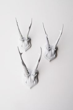 Faux Deer Antler Skull Caps - Faux Taxidermy - Set of 3 White Resin Deer Caps - Mounted Deer Antlers. $109.99, via Etsy.