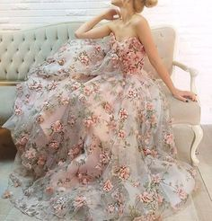 This #gown by Teuta Matoshi Duriqi is an absolute floral fantasy! 3D florals…