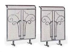 A PAIR OF ART DECO STEEL AND COPPER-PLATED FIRE-GUARDS  CIRCA 1925