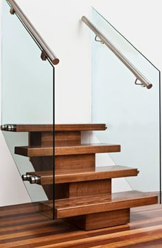 Timber central spine with patch fitted glass and stainless steel <br />round handrail Wrought Iron Staircase, Timber Staircase, Stair Railing, Railings, Glass Handrail, Glass Stairs, Staircase Manufacturers, Stainless Steel Staircase, Stairways