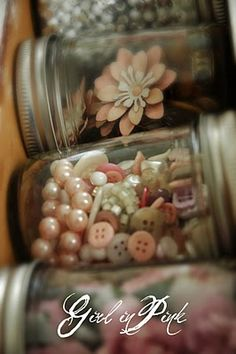 Jelly  jars for organizing pretty little things like jewelry and buttons.