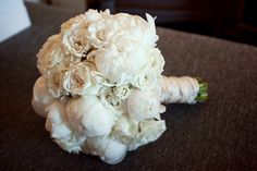 Eye-catching texture and a creamy white colour combine to make this peony bouquet both delicate and striking.