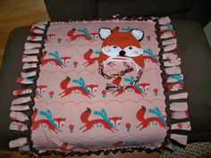 Crochet fox hat and no sew fleece blanket that I made for a coworker.  Her baby boy's nursery is the woodland animal theme.