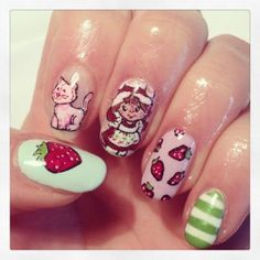 Spring Nail Art I'm sure I'll never do this but I LOVE that's it's Strawberry Shortcake. ;)