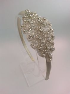 Solid satin Alice Headband Embellished with 5cm x 10cm crystal and diamante applique.    Available with cream or white band.    Absolutely