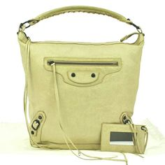 """""""HOST PICK """" Authentic Balenciaga Bag Ivory leather by Balenciaga. With dustbag and mirror. Actual pics,  Pls.dont ask more pics.  Keep in mind the  actual color is ivory.  The color choices below does not have ivory. Excellent condition! Made in Italy. Balenciaga  Bags Shoulder Bags"""