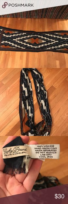 Lucky Brand scarf Beautiful Lucky Brand scarf. Colors are a dark navy blue and burnt orange with some white. Great condition and very soft. Can be styled in many different ways. Beautiful pattern. Lucky Brand Accessories Scarves & Wraps