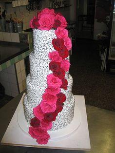 Black & white filigree wedding cake with pink & red Roses