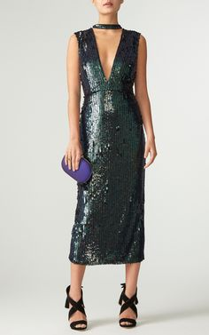 This **Sally LaPointe** Sequin Cut Out Dress is crafted of inky hued vertical sequins and features a fitted silhouette with a dramatic V-neck cut out.