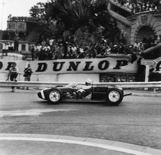 Stirling Moss in a Lotus-Climax 18, with the side panels taken out, during the Monaco Grand Prix at Monte Carlo, 14th May 1961. Moss went on to win the race