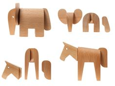 Dovetail Animals by Karl Zahn - three wooden shapes whose dovetail joints fit together to form an animal. Collect more than one and you can create hybrid animals!