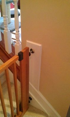 add a 1x to wall to keep dog gate from damaging the wall