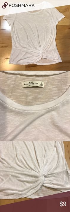 Abercrombie & Fitch white slub tissue tee Abercrombie & Fitch white slub tissue tee shirt with twist detail at the waist. Size medium. Great condition - only worn once. Non smoker home Abercrombie & Fitch Tops Tees - Short Sleeve