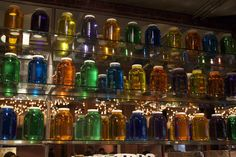 Jars filled with dyed water set as a backdrop -would be pretty with a light behind them.