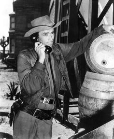 DUEL IN THE SUN (1946) - Gregory Peck (who stars as  'Lewt McCandles') makes a phone call between scenes - Based on novel by Niven Busch - Directed by King Vidor - Selznick International - Publicity Still.