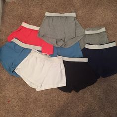 Soffee Shorts Bundle 2 Carolina blue, 2 gray, 1 black, 1 navy, 1 coral, 1 white. All size XS. All worn but still have life left. Pretty great deal for all these shorts! $5 each or $30 for all. Soffe Shorts