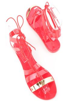 These stylish jelly sandals are a must have this season! The features include a PVC fabric upper in a strappy design, string tie closure, high polish strap vamp, open toe, and finished with a smooth lining.