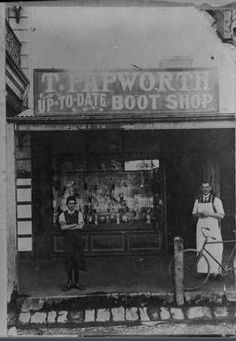 two workers in aprons outside the T. Papworth Boot Shop in Mount Gambier, SA ca.1890