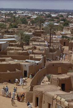 Kano, Nigeria. 1074390. Narrow streets lined by adobe buildings limit traffic.