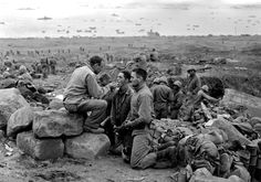 Soldiers receiving the Sacrament at Iwo Jima.