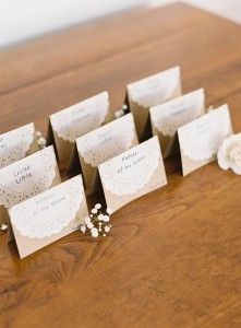 Kraft paper escort cards with a touch of lace.  Photo by Adam Barnes.