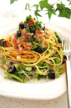 Fresh pasta salad of tomatoes and watercress