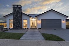 White Home | Show Home | Exterior | Architecture | Chimney | Fire | Schist Cladding Storey Homes, White Houses, Cladding, New Zealand, Garage Doors, Floor Plans, Layout, Fire, Flooring