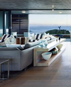 Modern beach house. - I don't know which is better, the design of the living room, or the view. #beachhousedecorlivingroom