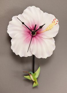 NEW PENDULUM CLOCKS! Beautiful flower blooms transformed into decorative hanging timepieces. Our swinging pendulum clocks are a fun way to keep time with nature! Uses one AA battery, not included. Tick Tock Clock, Pendulum Clock, Lighted Canvas, Time Clock, Antique Clocks, Glass Birds, Decoration, Gifts For Family, Diy Art