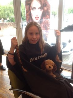 Schoolgirl raises almost £500 by cutting her long hair (From South Wales Argus)