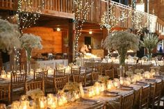 Barn Weddings: Reception Seating Long rectangular tables with neutral colors lend themselves to barn and natural settings (wedding reception table decorations babies breath) Rustic Wedding Centerpieces, Candle Centerpieces, Reception Decorations, Table Decorations, Jar Candles, Homemade Decorations, Wedding Reception Seating, Wedding Table, Reception Table