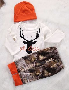 "This handmade outfit is beyond adorable for a baby boy on the way, or newly arrived. Pants and beanie hat are made out of a super soft stretchy jersey knit. Cotton Onesie. Blaze Orange Words "" Oh Deer"