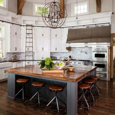 Farmhouse Kitchen Design   Love This Ginormous Wood Island With Seating For  6 (love The Floor Color Too U0026 Of Course Ceiling And Beams + Lighting)
