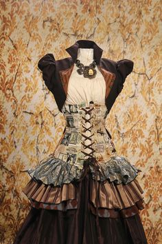 Vintage French Steampunk Corset by Damsel in this Dress via etsy.com  I'd buy this but why must the waist be 28 .-.