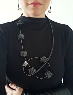 Fabulous contemporary necklace, made of black pvc tube, black ecoleather, aluminum and steel wire string cord. Finished with lobster clasp. Length: 81 cm A must have accessory to jazz up your wardrobe. Package will be shipped out as soon as I possibly can which is usually 3 - 5 days after