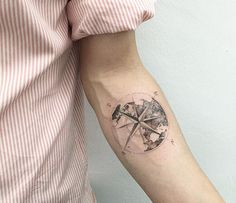 Earth and compass tattoo