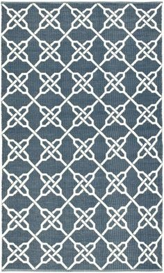 Coastal chain in nautical navy by Thom Filicia for Safavieh. Eco-friendly outdoor rug from recycled soda bottles