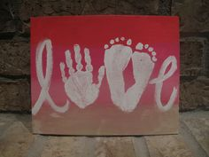LOVE canvas using child's hand and feet.  This would be a great Mother's Day or Father's Day gift.