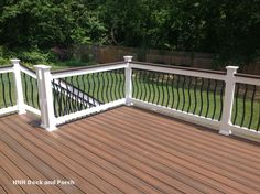 @trexcompany  decking with black brogue aluminum balusters with white PVC railing and Vintage Lantern cap rail.