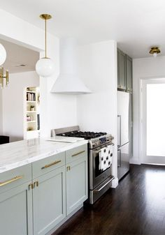 Cabinets in farrow & ball pigeon, white vent hood that disappears into the wall