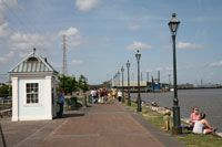 The Moon Walk is a riverside promenade that was created in the 1970s along the Mississippi river. It is popular with tourists who watch the many boats passing by or listen to one of the street musicians.    Moon Walk