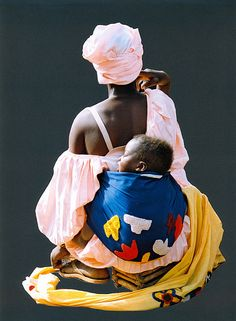 Africa |  People.  Mali.  Words from photographer ' I saw this woman in a market. She looked very special with her sleeping baby .'