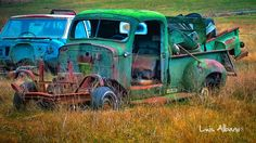 Pieces of a vintage green tow truck..