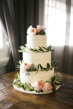 Wedding cake with olive leaves and peach roses